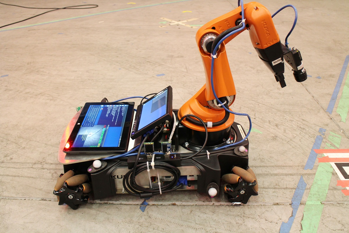 Fig. 2: The group used standard development platforms such as the ground-based Kuka YouBot to test their system. Natural features in the environment are tracked with the arm-mounted camera while wheel encoders provide odometric data. White spherical markers on the body of the robot are tracked by external motion capture sensors. These multiple sources of on-board and off-board information are integrated by the on-board computer.