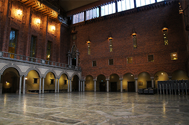 "The Blue Hall of the Stockholm City Hall, the venue of the Nobel Banquet. Named the ""Blue Hall"" because initial plans called for the room to be painted blue, it was built with bricks instead"