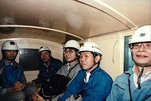 Takaaki Kajita with Professor Koshiba and other colleagues on a minecart in the Kamioka Mine, when Kamiokande was under construction