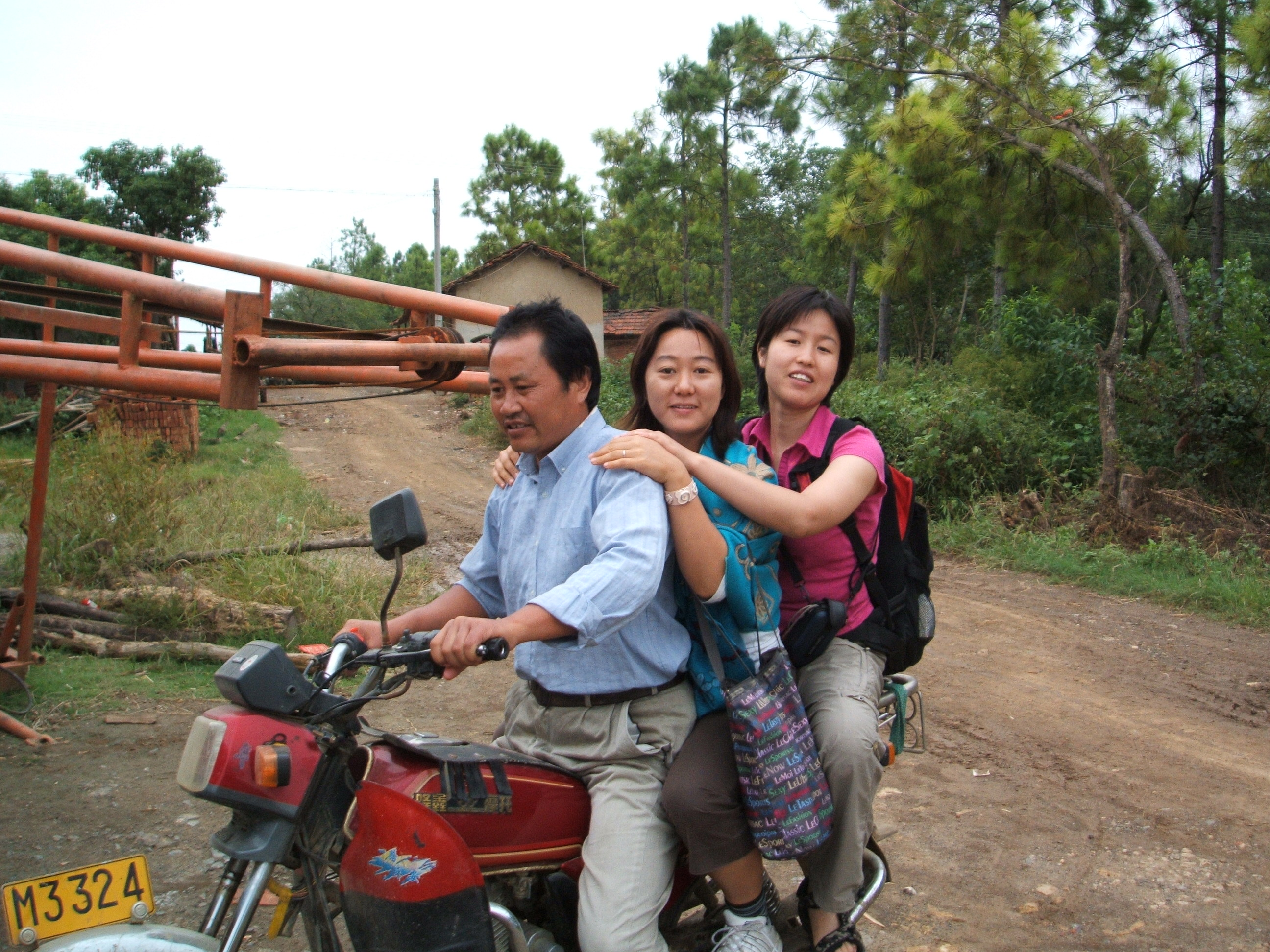 Figure 2: Traveling by motorbike to a Chinese village to conduct research