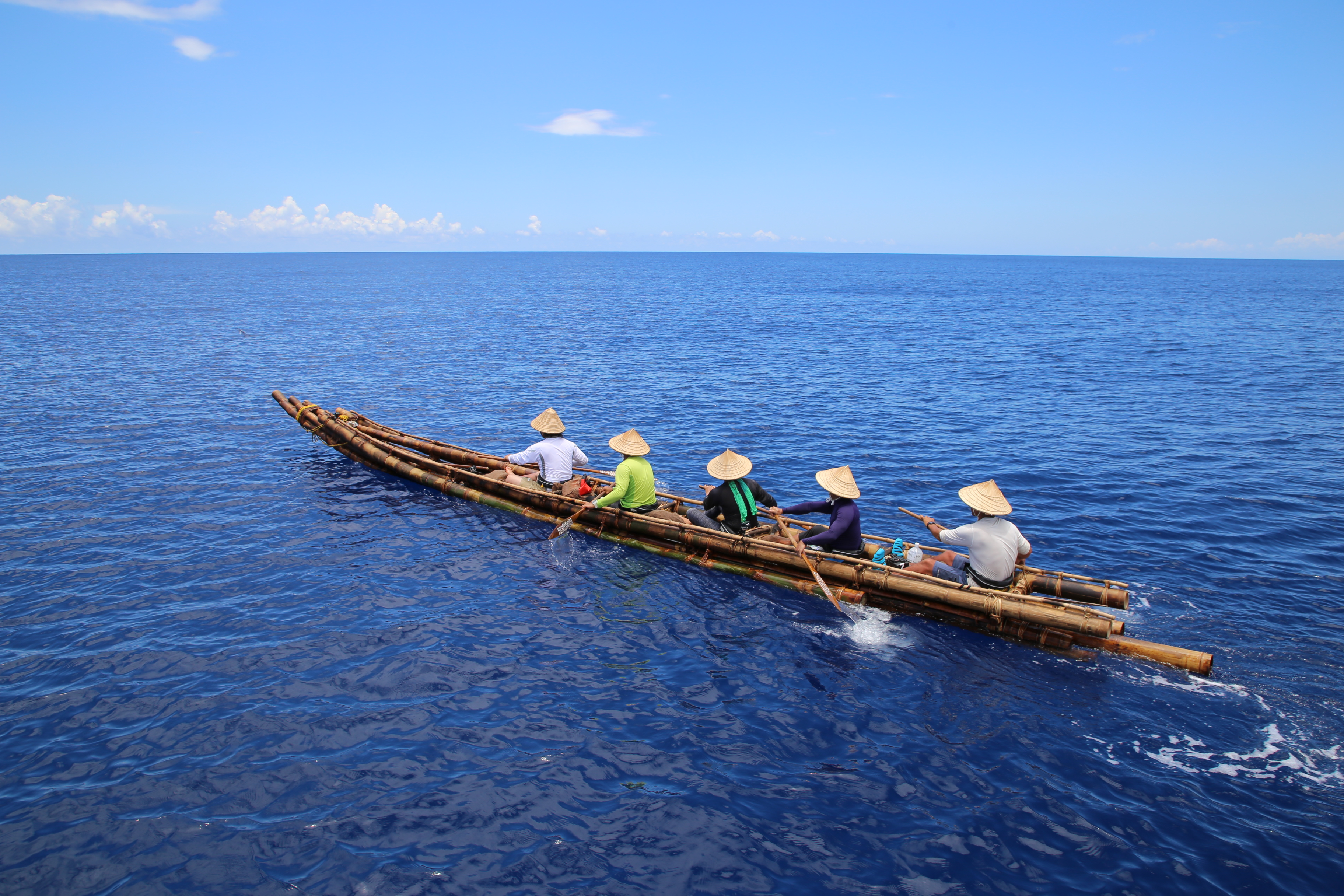 A simple wooden craft on a blue ocean
